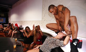 Interracial party with Ebony chicks doing blowjob and receiving cumshot