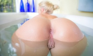Blonde babe with tight ass Payton Simmons shows off her wet pussy