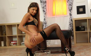 Pissing action features European babe with a shaved pussy Melena