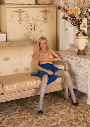 Close up posing session with a blonde milf babe Angel P in stockings