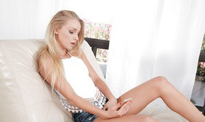 Teen babe with blonde hair Staci Carr masturbating her pussy