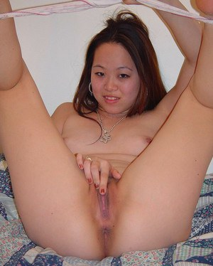 Sweetie babe China spread her legs on the bed and plays with pussy