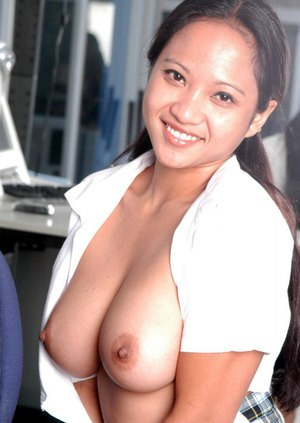 busty Chinese brunette Loni smiles in her cam and plays with her clit