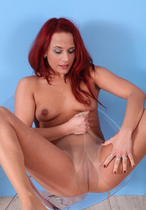 Redhead babe Terry is pissing and drinking her piss with smile