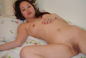 Chinese chick with tine boobies is playing with her sexy pussy