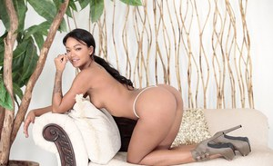 Tattooed ebony Harley Dean poses naked and plays with her booty