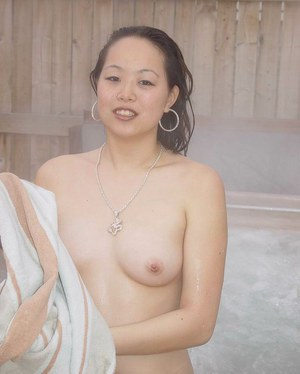 Asian cutie China is taking Jacuzzi and touching her nice holes