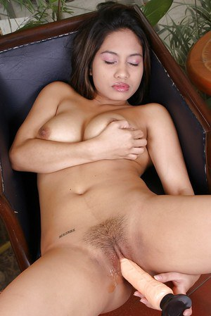 Asian model with ideal look is drilling her hairy pussy with toys
