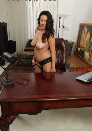 Office secretary DeSire Delgoto shows her nice big boobies on cam