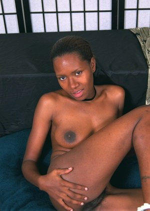 Amateur African chick Dazy plays with her all-natural boobies
