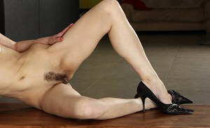Skinny Asian brunette Halle B. is penetrating her puss with pleasure