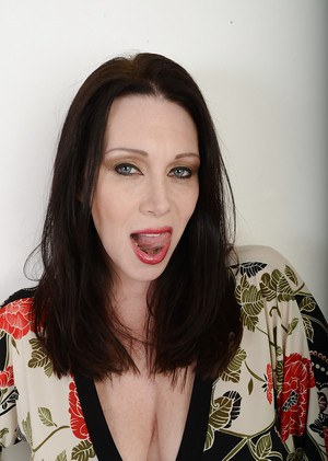 Mature brunette Ray Veness is masturbating and dreaming about dicks