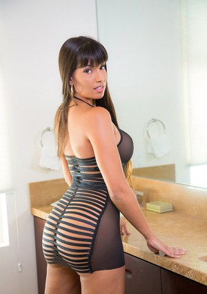 Mercedes Carrera demonstrates her amazing juicy booty in the office