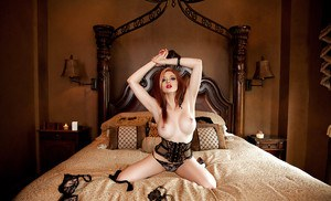 Big-tit redhead beauty Chandler South is lying naked in the bedroom