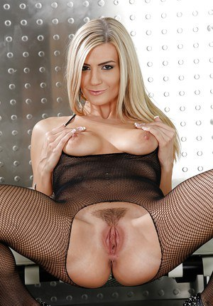 Sweet-looking blonde Amanda Tate is touching her accurate snatch