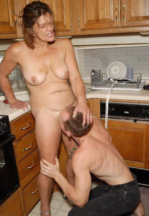 Tanned mature woman Ivee is getting drilled in her wide asshole