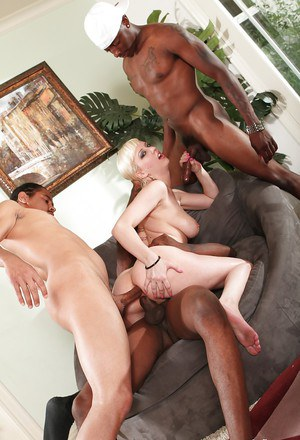 Tattooed blonde Cherry Torn in a hardcore interracial gangbang