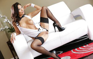 Asa Akira poses naked in her awesome black stockings and high heels