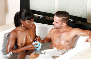slender ebony Ana Foxx gives a hot oral massage in the bathroom
