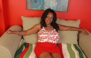 Fatty ebony Yvette shows her awesome big natural boobies on sofa