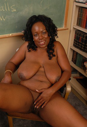 Kinky fatty ebony Yvette demonstrates her awesome big boobies