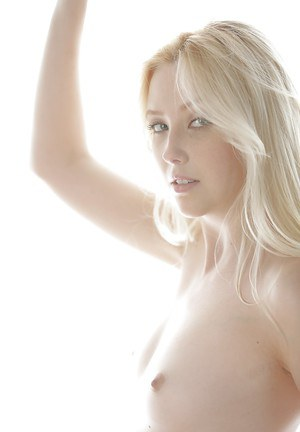 Teen blonde Samantha Rone is slowly undressing her cute panties