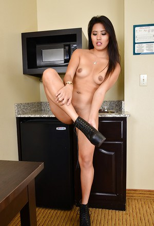 Smiling Asian Angelina Chung is presenting and touching her pussy