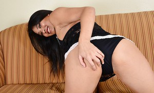Slender tanned Asian babe Angelina Chung shows off her big ass
