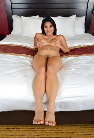 Asian beauty Angelina Chung is spreading her awesome legs on the bed