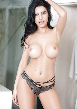 Slender beauty with awesome big tits Laura Cattay shows her shape