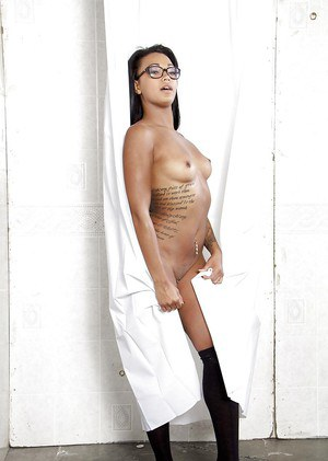 Gorgeous ebony Harley Dean is playing with her slender tanned body