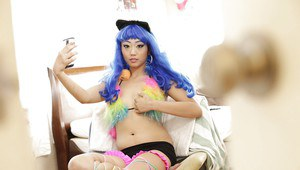 Blue-haired Asian Miko Dai is showing off her small boobies!