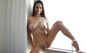 Smiling gonzo chick Ashley Adams showing off her big natural boobs