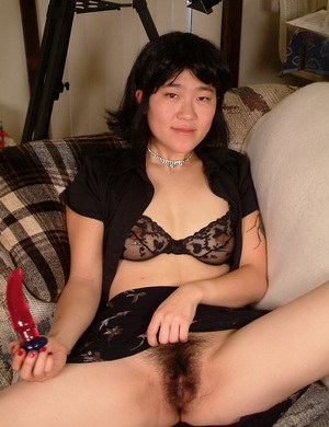 Gorgeous Asian model Cady demonstrates her pretty hairy vagina