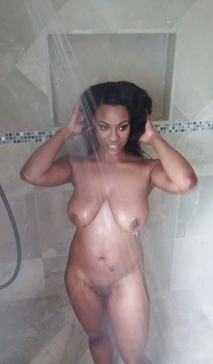 Ebony Tori Taylor is taking bath and touching her wet boobies