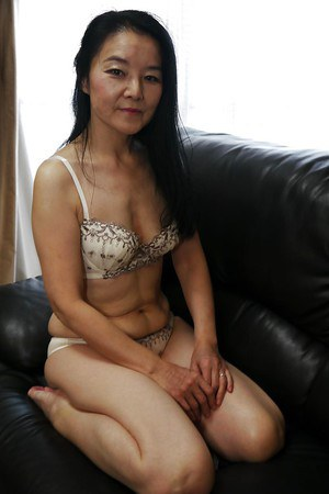 Voluptuous Asian milf Takako Numai lets us see her wet mature pussy