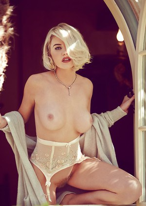 Teen blonde Kayslee Collins poses outdoors for centerfold pictures