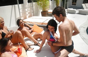 Enjoying a prick by the pool with friends is Loni Evans' idea of fun