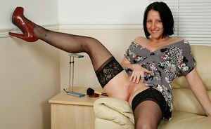Matute babe Amber Clare wears stockings while spreading her phat butt
