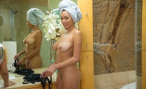Ebony babe Serena Ali has a freshly shaved black cunt after shower