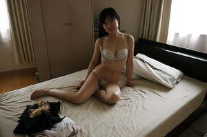 Asian Milf babe Ayane Ikeuchi posing in schoolgirl uniform and hose