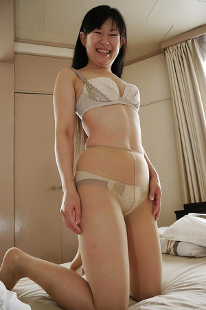 Asian babe Ayane Ikeuchi posing in skirt and pantyhose bares tiny tits