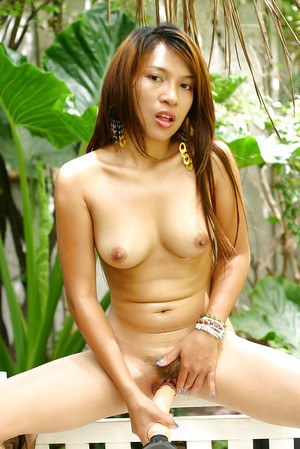 Sexy Thai sweetie masturbates her neatly trimmed Asian pussy with toy