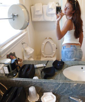 Pretty amateur Whitney likes to take selfies and show off her pussy