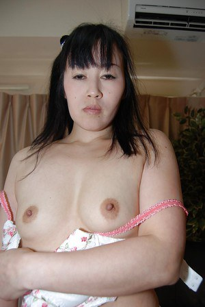 Oriental woman Hiromi Mishima stripping out of work clothes and nylons
