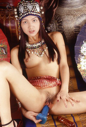Perfect Thai hottie masturbates her hairy swollen cunt and fondles tits