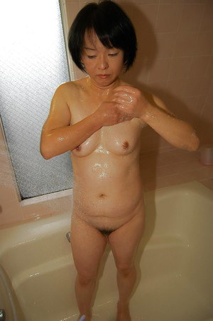Asian granny Tomoe Nakamachi stripping and taking hairy cunt to shower