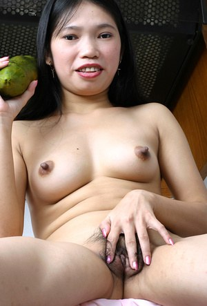 With a big piece of produce amateur Asian Diep stroked her hairy pussy
