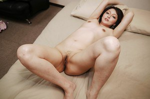 Oriental babe Mika Aoto stripping off her brassiere and panties