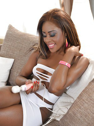 Young ebony chick Maria Ryder uses a vibrator on her shaved black cunt